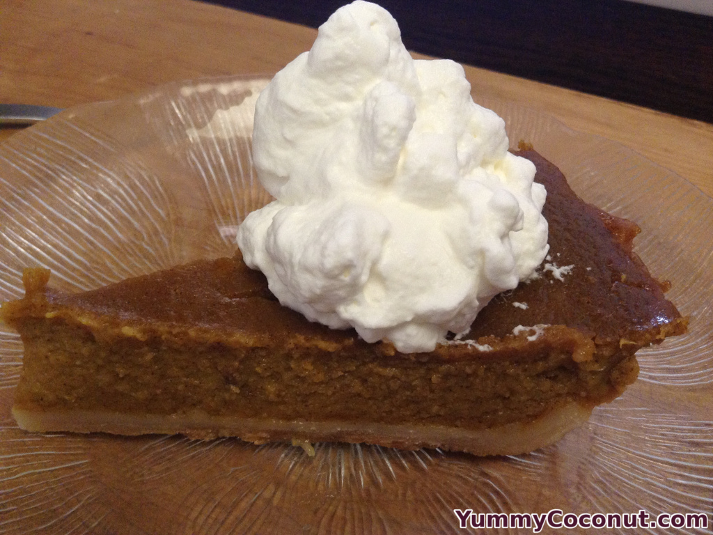 Slice of pumpkin pie with coconut milk